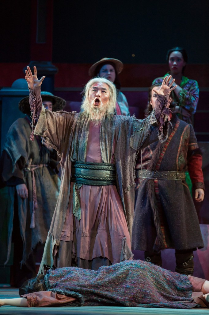 Bass Young Bok Kim mourns the loss of Liu.  Photo by Rod Millington and Sarasota Opera