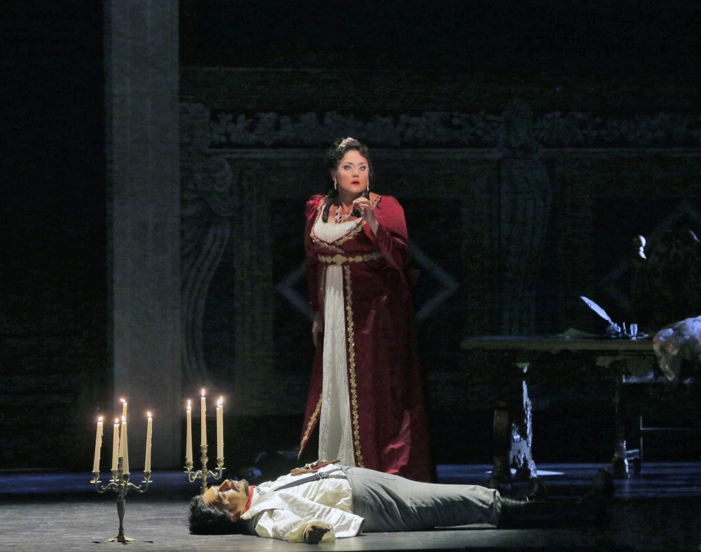 Tosca (Kara Shay Thomson) stands over the body of Scarpia (Luis Ledesma). Photo by Ken Howard