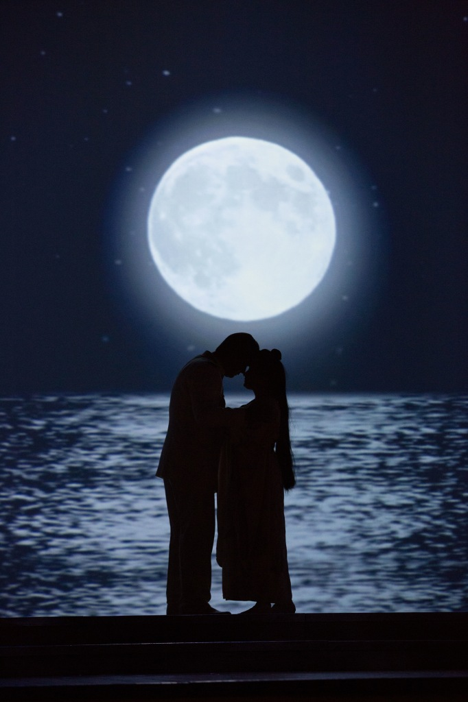 Pinkerton (Adam Diegel) and Cio-Cio-San (Dina Kuznetsova) kiss under the full moon. Photo by  Jeff Roffman.